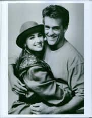 """John Wesley Shipp as Barry Allen / Flash and Paula Marshall as Iris West, striking a pose, smiling, from """"The Flash"""" (1990 TV series)."""