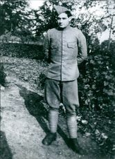 Hans Parser, standing in this image; he was a soldier in the Dutch army wherein he defended a bunker near a German border; bunker was bomb and Hans Parker's death was reported and 3 months later he returned to German captivity.