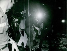 A vintage photo of a riot between police, soldiers and local citizen of Vietnam during war in Vietnam.