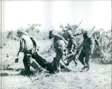 American soldiers recovered a body of their fellow soldier. 1967