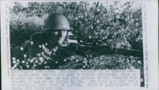 Russian Soldier holding gun and aiming during the war.  1943