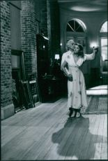 """A photo of Terence Stamp and Sheryl Lee dancing together during a movie scene """"Bliss""""."""