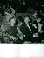 """Jean-Alfred Villain-Marais siting with Elsa Martinelli and Magali Noell watching their movie premier in Paris, """"The Captain"""" .  1960"""