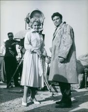 """Maria Schell and Raf Vallone, preparing to be starred in a film called """"A Storm on the Po River""""."""