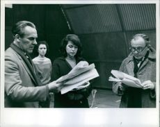Eva Bartok rehearses for her first starring role on television with John Le Mesurier, left and Henry Oscar, right.
