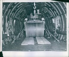 """A road roller-- a real-- heavyweight-- takes its place for transport to a forward area. Much of the equipment the Boeing C-97 Stratofreighter carries is useful in building airfields and roads after a """"beachhead"""" has been established."""