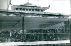 A Buddhist temple is being guarded and a barbed wire is put in the main gate to assure safety of the area during Saigon war.