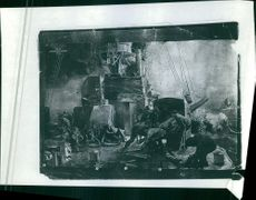 A vintage photo of French armies in a ship bombing the shore and fighting against German.