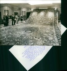 A Eichmann Carpet up for auction is withdrawn after reaching only a bid of 11,500 pounds.