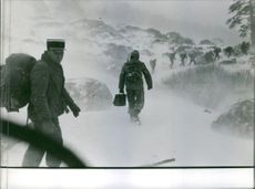1963  Bastia-kataotofen(Bastia disaster)  French soldiers walks in sigle file on a very cold weather.