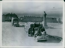 Italian prisoners on an Australian lorry on their way to the port where they will embark for the prison camp. 1941.