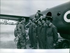 A photo of Prince Philip, Duke of Edinburg in a command of his men before boarding the airplane.