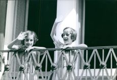 Santina and Giuseppina Foglia waving from the balcony. 1966.