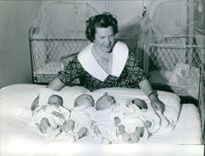 Woman photographed with four children.