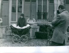 Prince Alexander of Yugoslavia taking pictures of Princess Maria Pia of Savoy and their children. 1959.