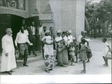 Parishioner and a priest outside the church in Kongo, 1964.