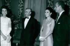 Prince Juan Carlos Borbón and his wife, Princess Sofía of Greece and Denmark, pictured with Shah Pahlavi and Farah Pahlavi at a perty. 1969.