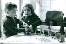 Children siting and playing with their toys.