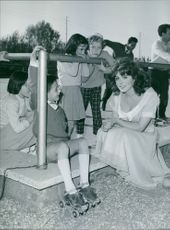 Tina Louise siting with children.