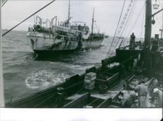 People working on the ship.