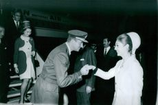 Princess Sofia arrived in the airport. Don Juan Carlos greeting Princess Manijeh, wife of Prince Gholam of Persia.