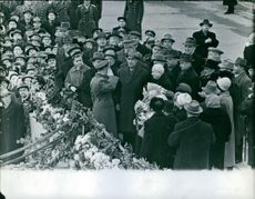 Nikita Khrushchev being welcomed by the people during an event.