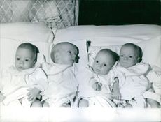 Quadruplets babies lying in bed.