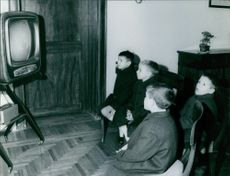 Four young boys watching television in a room, 1967.