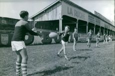Children playing rugby in a playground.
