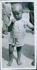 A 5-year-old lad at the orphanage, Seoul, Korea, 1951.