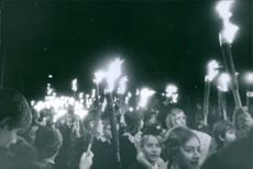 People gathered on the street, holding a torch, 1968, to give honor richard benedikte.