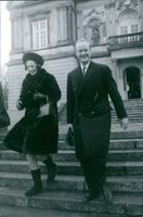Richard, 6th Prince of Sayn-Wittgenstein-Berleburg and Princess Benedikte of Denmark, pictures stepping down the stairs.