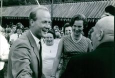 Princess Benedikte of Denmark and Richard, 6th Prince of Sayn-Wittgenstein-Berleburg seen exchanging pleasantries with a man.