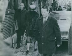 Juliana, Queen of the Kingdom of the Netherlands, seen wearing a fur jacket and a hat during her stroll in the street. 1965.