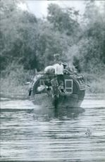 1966 Vietnamese refugees on boat in Cambodia.