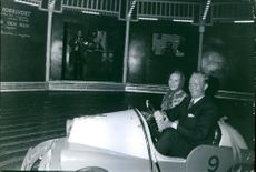 Richard, 6th Prince of Sayn-Wittgenstein-Berleburg and Princess Benedikte of Denmark, enjoying themselves riding the bumper car.