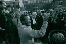 "1969  A photo of an English sailor Sir William Robert Patrick ""Robin"" Knox-Johnston in a crowd of people saying maybe something important information to those people around him and photographers taking pictures of him."