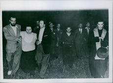 Signor Buffarini being led for execution. A Priest who accompanied him is seen on right. 1945.