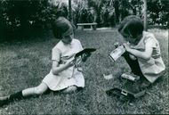 Two young girls playing in the garden. 1966.