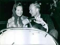 Princess Benedikte of Denmark RE, and Richard, 6th Prince of Sayn-Wittgenstein-Berleburg, seen riding a bumper car. 1967.