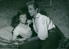 Jarl Kulle  and Ulla Jacobsson in the film Sången om den eldröda blomman, 1956.
