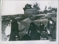 Women and children returning to their village in the Rzhev area, after its liberation from the Germans.