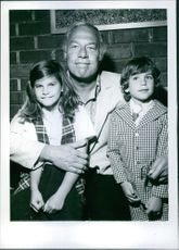 """George Kennedy with children Karianne and Chris at the party given for the Premier of """"Willy Wonks"""" and the Chocolate Factory."""