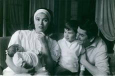 Daniel Gelin having fun with his wife Sylvie Hirsh and his two kids.
