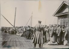 Japanese soldiers standing and gathered on the port during the Russo-Japanese War, 1905.