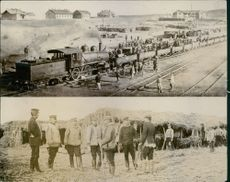 Soldiers working together in the railway track during Tyskland War.