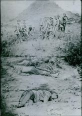 Soldiers are burying dead body.