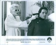 Brigitte Nielsen and Paul Reiser in a scene from the film Beverly Hills Cop II.