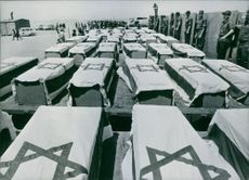 The flag-draped coffins of 39 Israeli soldiers killed in the Yom Kippur war in 1975.