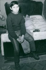 1969 - Two children in a bed. Aline 13 years old and Francis 7 years old.